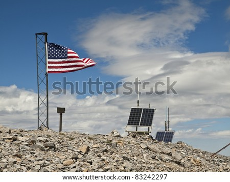 The US flag and solar weather stations high on top of 11916 foot Mt Charleston in Southern Nevada.