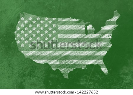 the us-Flag in shape of the usa drawn on a backboard - stock photo
