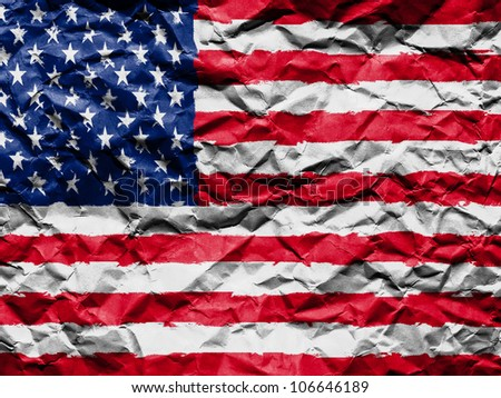 The USA flag painted on crumpled paper