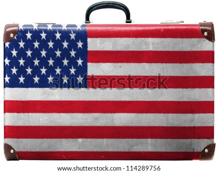 The USA flag painted on old grungy travel suitcase or trunk