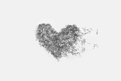 The used staples are placed as a heart shape on white background.