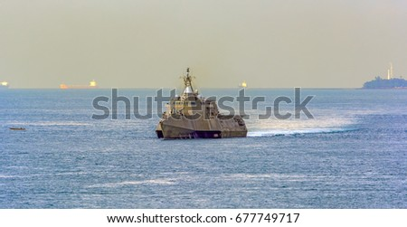 The USN Independence-class littoral combat ship passes Singapore Strait. stock photo