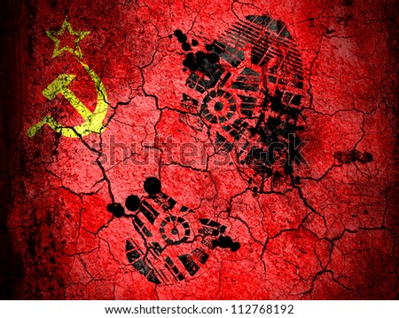 The USSR flag painted on  cracked ground with vignette with dirty oil footprint over it