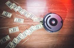 the vacuum cleaner sucks the money. money disappears
