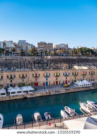 The Valletta Waterfront, is a promenade in Floriana, Malta, mainly featuring three prominent buildings. The area is now a hub in Malta's cruise liner business as the Forni Cruise Passenger Terminal. #1310559290