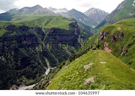 The valley of Georgian Military Highway, Caucasus mountains, border between Georgia and Russia