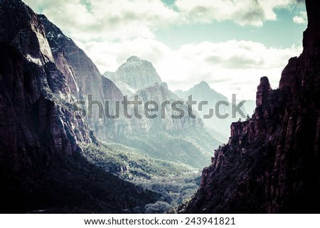 The valley of Zion National Park with the Virgin River surrounded by the tall mountains and cliffs of the canyon. #243941821