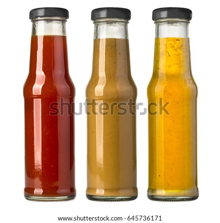 the various barbecue sauces in glass bottles #645736171
