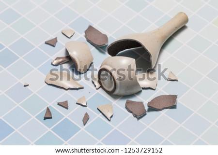 The vase broke on the floor #1253729152