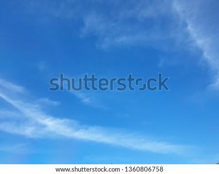 The vast blue sky, bright colors, partial clouds