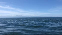 The vast expanse of ocean waters.