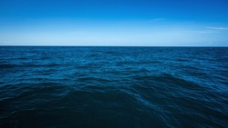 The vast ocean in the winter, Dark and deep ocean with blue sky