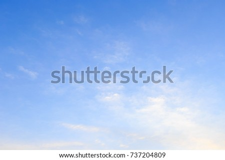 The vast sky and the white clouds float in the sky. The natural blue background has a breeze on a bright day in the summer.The sky and clouds are not the same shape as the weather. #737204809
