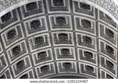 The vault of Triumphal arch in Paris is decorated with a geometric pattern (the basis of put one in the other squares) with flowers, carved flower, glyptic. stone ornamentation, crown molding #1285224487