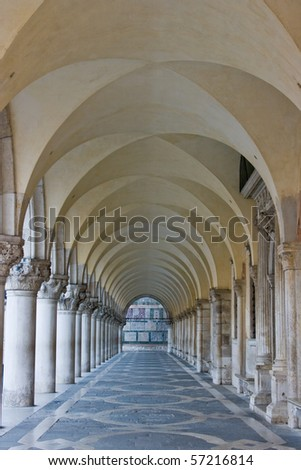 The vaulted colonnade at the front of the Doges Palace in Venice Italy