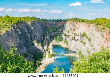 The Velka Amerika limestone quarry also know as 'Czech Grand Canyon' near Karlstejn castle in the protected landscape area of Czech Karst. Stok fotoğraf ©