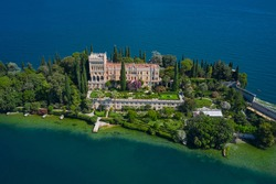 The Venetian neo gothic Villa Borghese Cavazza. Is the biggest island on Lake Garda. Aerial view of the island Garda, Lake Garda, Italy Aerial photography.