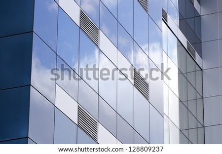 The ventilation grids,exterior facade of building covered with glass reflections of the clouds taken.ventilation grills to be emphasized in this photograph and the glass-clad building on the original