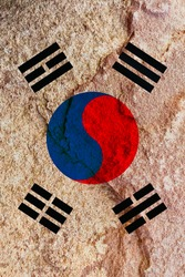 The vertical South Korea flag symbol on pale red rock wall, South Korea national flag pattern texture