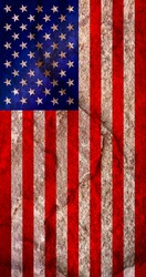 The vertically hanging American flag on weathered pale red rock wall, USA national flag texture background, political independence concept texture
