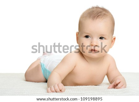 the very  beautiful  little baby , lie on stomach,  on white background, isolated