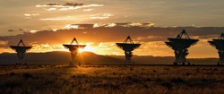 The Very Large Array, which is a large array of satellite dishes that is used to probe deep space (from Contact), is seen at sunset.