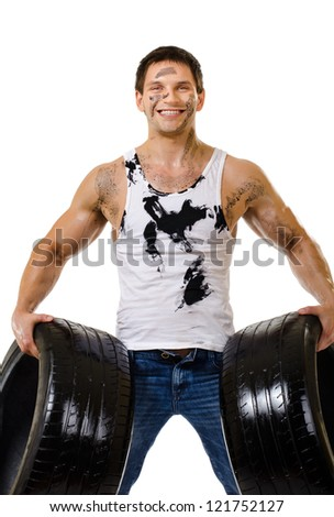 the very muscular handsome sexy guy hold rubber-tire and white,  on  white background, isolated