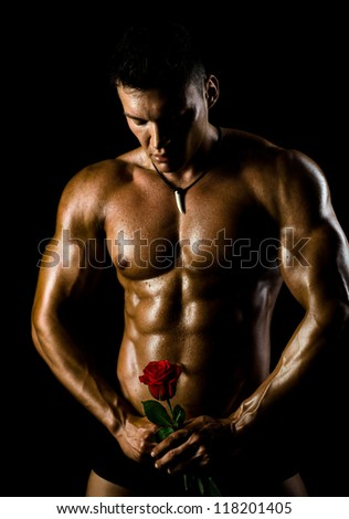 the very muscular handsome sexy guy on black background, naked  torso