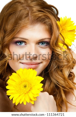 the very  pretty red-haired blue eyed young woman  with yellow flower,  smile , vertical close up portrait