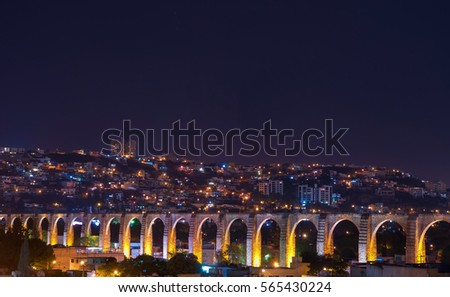 The viaduct of Queretaro city and its skyline at night, Mexico.