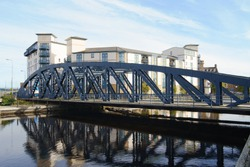 The Victoria swing bridge at Leith Docks, Edinburgh, Scotland, UK.  Constructed fro 1871 to 1874, now disused.  The new flats behind the bridge are part of the redevelopment of Leith.