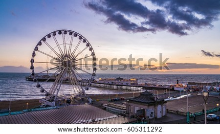 The Victorian Brighton Pier, also known as the Palace Pier and the Brighton wheel at sunset #605311292