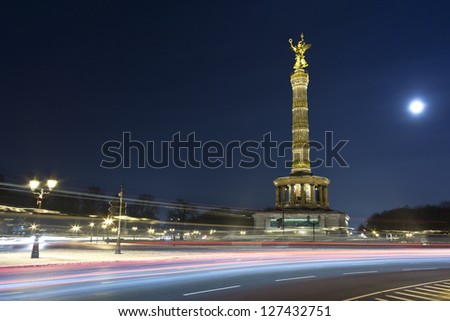 The Victory Column is a famous sight in Berlin. Impressive Siegessaule monument with its golden angel overlooking the huge Tiergarten park in Berlin at night.