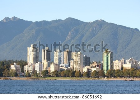 The view across English Bay, the apartments and condominiums of the West End, and the North Shore Mountains in Vancouver. British Columbia, Canada.