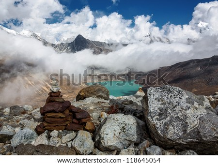 The view from the Renjo Pass (5360 m) on the lake Dudh Pokhari and the village of Gokyo - Nepal, Himalayas