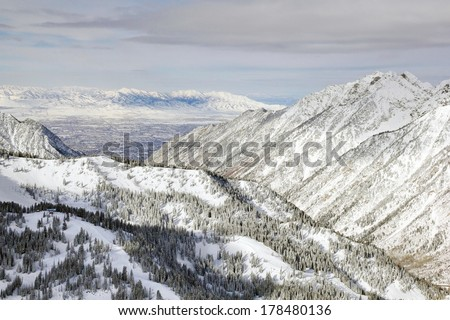 The view from the top of Snowbird Ski Resort, in Utah looking down across the valley to Salt Lake City in winter.