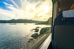 The view from the train window overlooking the sea.