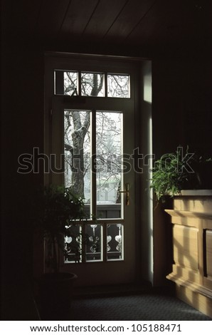 The view from the warm rooms in the winter forest, Austria - stock photo