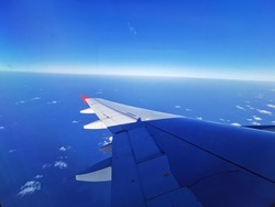 The view from the window in the cabin part of the wing of the Airlines plane