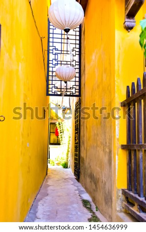 The view in the atmosphere of the building with narrow corridors between unique buildings, colors in Hoi An, famous, world famous cultural heritage and diverse architecture. #1454636999
