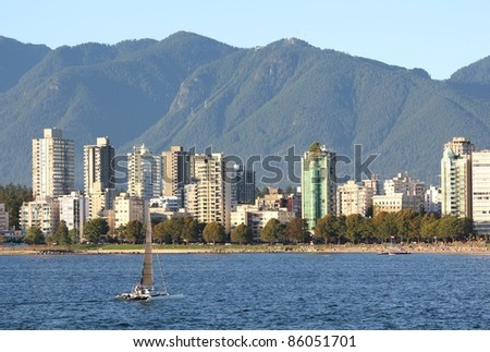 The view, in the early evening, across English Bay, the apartments of the West End, and the North Shore Mountains in Vancouver, British Columbia, Canada.