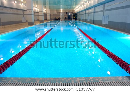 the view of a swimming pool indoors