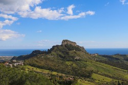 The view of an italian landscae in which we can see a gigant stone from the Gerace town in a beautifull sunny day