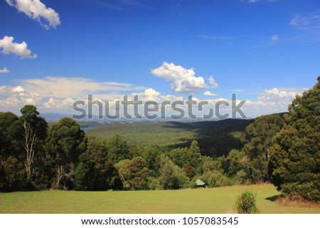 The view of forested mountain slope from Kalorama Park in Dandenong Ranges, Australia.  #1057083545