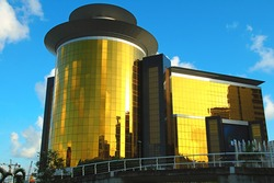 The view of golden commercial building over blue sky