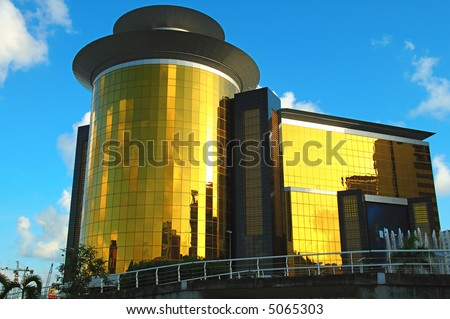 The view of golden commercial building over blue sky - stock photo