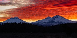 The view of Mt Bachelor and the three sisters from Sisters Oregon during sunset, cascade mountain range