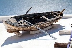 The view of old boat on the roof Santorini village Firostefani