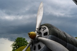 The view of propeller and motor of military cargo aircraft. The blurred cloudy sky.