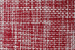 The view of red and white wickerwork pattern with soft focus. The flat view of wickerwork background.